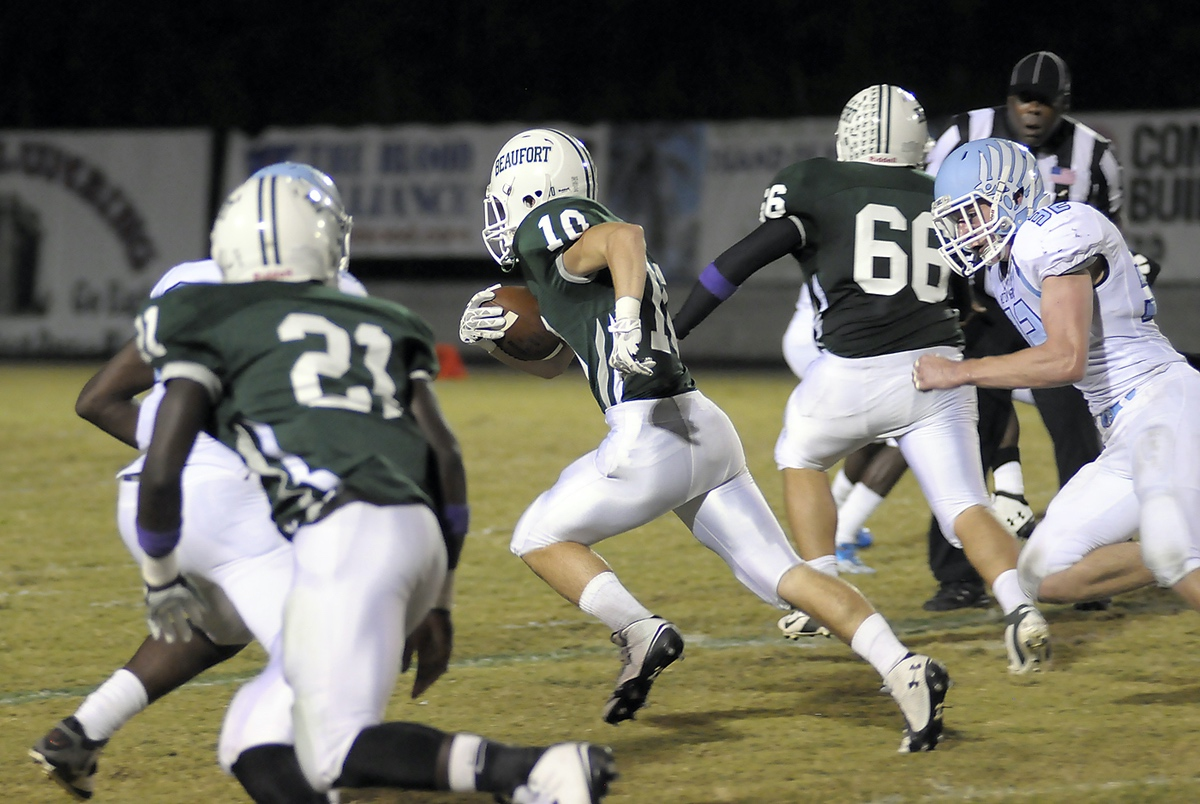 Wyatt Sherpensky, center, finds a big opening in the Hilton Head defense  and punches